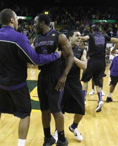 Angel Rodriguez celebrates following Kansas State's 57-56 win at ninth-ranked Baylor on Saturday at the Ferrell Center.