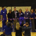K-State dignitarites, donors, plus Rodney McGruder & Brittany Chambers take part in a ribbon cutting ceremony of the new basketball training facility.