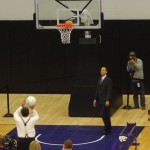 K-State president Kirk Schulz attempts a free throw in the new K-State basketball practice facility.