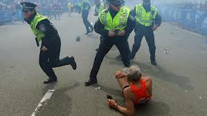 Boston Police Officers tend to a fallen runner