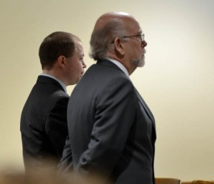 Miles Theurer (on left) stands with defense attorney.