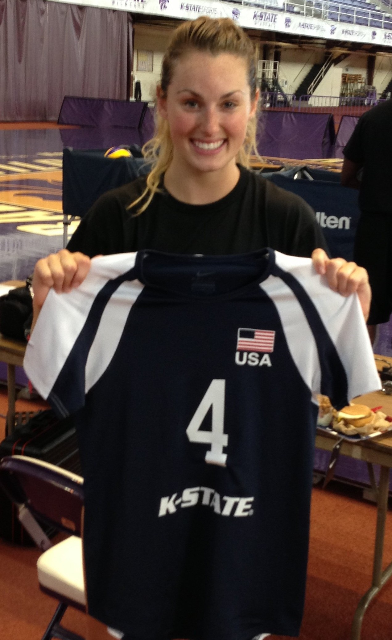 Manhattan native and K-State senior libero Tristan McCarty holds the Team USA jersey the Cats will wear in Russia.