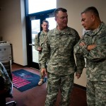 Maj. Gen. Paul E. Funk II (left), 1st Inf. Div. and Fort Riley commanding general, tells Gen. John F. Campbell , Army vice chief of staff, how Soldiers utilize the post's Warrior Zone during a tour Oct. 29. Among its many features, the Warrior Zone offers Soldiers access to computers for gaming or online courses, videos games and a theater.  (Amanda Kim Stairrett, 1st Inf. Div.)
