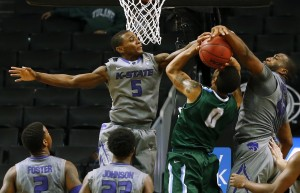 K-State's Jevon Thomas (5) and Thomas Gipson (42) block the shot of Tulane's Louis Dabney (0) during the second half.