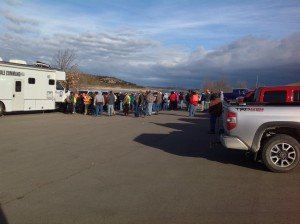 Large group of volunteers gather to search for Peterson at Tuttle Cove Dock area.