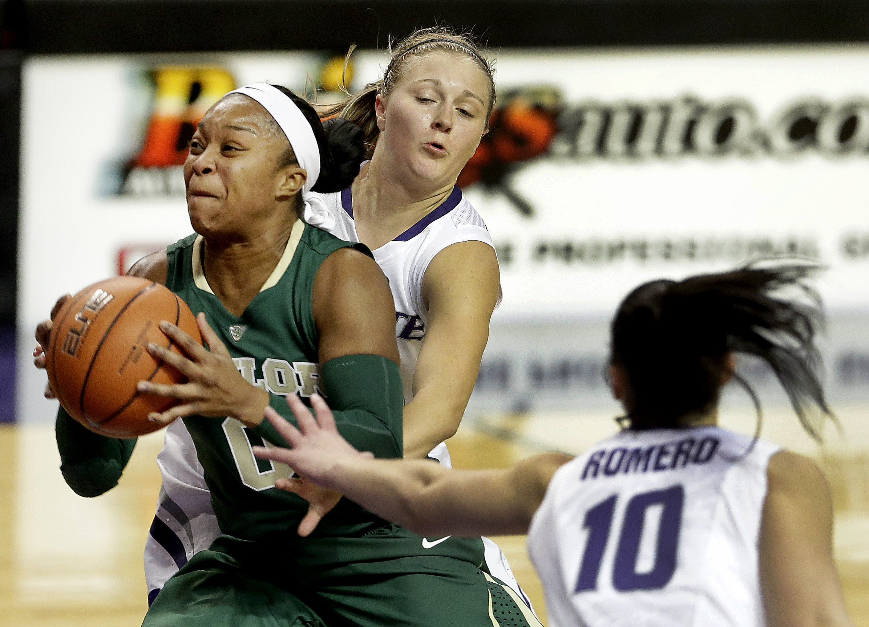 Baylor's Odyssey Sims (0) gets past Kindred Wesemann, center, and Leti Romero (10) on her way to the basket at Bramlage Coliseum.