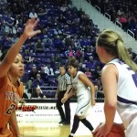 K-State's Kindred Wesemann looks to pass against Texas' Celina Rodrigo during Wednesday night's game at Bramlage Coliseum. (Photo by Erik Stone)
