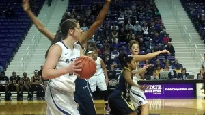 K-State's Ashlynn Knoll looks to pass the ball as teammate Katya Leick shouts instructions during the first half of Saturday's game against West Virginia (Photo by Erik Stone)