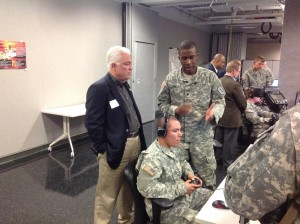 Manhattan City Commissioner Rich Jankovich engages with soldiers operating simulator.
