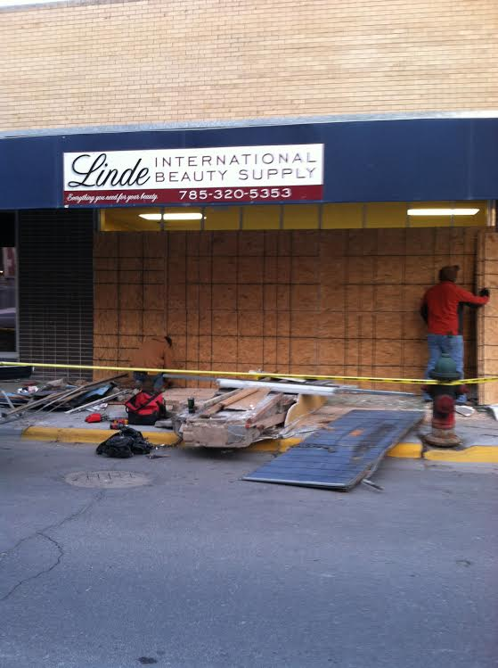 Vehicle slams into Downtown business