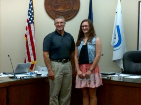 Kansas County Official of the Year-Dennis Peterson with scholarship winner-Emma Glessner