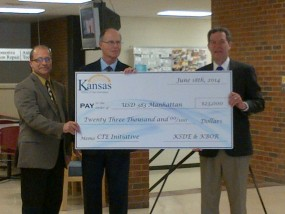 (from left to right) USD 383 School Board President, Curt Herrman; USD 383 Superintendent, Bob Shannon and Governor Sam Brownback