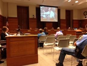 RCPD Dir. Brad Schoen on screen; photos by Cathy Dawes