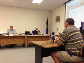 Commissioners Stan Hartwich and Gary Yenzer listen to Mark Karmann of Junction City/Geary County
