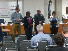 School Board President, Leah Fliter presents a few board members with the Honor Roll Level 1 achievement
