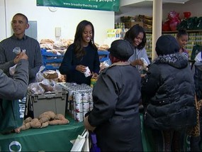President Obama and Family Hand Out Food