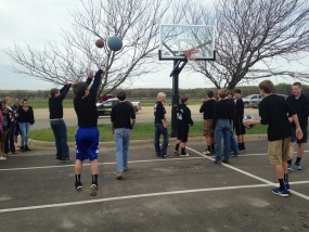Players from the Rock Creek Junior High boys basketball team open the new goal by taking the first official shots.