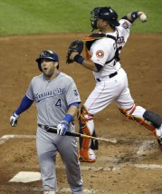 Kansas City Royals' Alex Gordon (4) heads for the dugout after striking out as Houston Astros catcher Hank Conger throw the ball to the mound in the fourth inning of a baseball game Tuesday, June 30, 2015, in Houston. (AP Photo/Pat Sullivan)