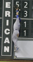 Kansas City Royals left fielder Alex Gordon jumps high but can't get a glove on the ball for a double for Houston Astros' Jon Singleton in the eighth inning of a baseball game Monday, June 29, 2015, in Houston. (AP Photo/Pat Sullivan)