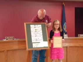 Photo by Joyce Mermis-Mayor Cliff Baughman issued a proclamation to Arbor Day winner Rachel Estes