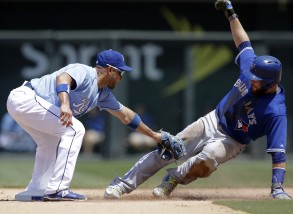 Kansas City Royals second baseman Omar Infante, left, tags out Toronto Blue Jays' Russell Martin, right, during the sixth inning of a baseball game at Kauffman Stadium in Kansas City, Mo., Saturday, July 11, 2015. Martin was caught stealing on the play. (AP Photo/Orlin Wagner)