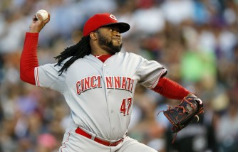 FILE - In this July 25, 2015, file photo, Cincinnati Reds starting pitcher Johnny Cueto works against the Colorado Rockies in the seventh inning of a baseball game Saturday in Denver. The Kansas City Royals acquired Cueto in a trade with Cincinnati on Sunday, July 26, 2015, sending three prospects to the Reds for a legitimate ace for the front of their beleaguered rotation. (AP Photo/David Zalubowski, File)