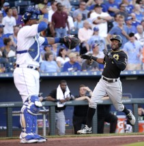 Pittsburgh Pirates' Starling Marte, right, crosses the plate in front of Kansas City Royals catcher Salvador Perez to score on a single by Pedro Alvarez during the second inning of a baseball game Monday, July 20, 2015, in Kansas City, Mo. (AP Photo/Charlie Riedel)