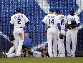 Kansas City Royals left fielder Alex Gordon receives attention after sustaining an injury while attempting to field an inside-the-park home run by Tampa Bay Rays' Logan Forsythe during the fourth inning of a baseball game Wednesday, July 8, 2015, in Kansas City, Mo. (AP Photo/Charlie Riedel)