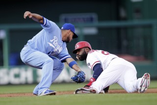 St. Louis Cardinals' Jason Heyward, right, steals second base as Kansas City Royals second baseman Omar Infante, left, is late with the tag in the second inning of a baseball game, Thursday, July 23, 2015, in St. Louis. (AP Photo/Tom Gannam)