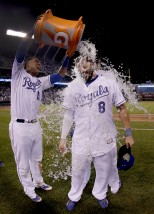 Kansas City Royals' Salvador Perez (13) dunks Mike Moustakas (8) after their baseball game against the Pittsburgh Pirates Wednesday, July 22, 2015, in Kansas City, Mo. The Royals won 5-1. (AP Photo/Charlie Riedel)