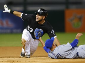 Chicago White Sox left fielder Melky Cabrera (53) looks toward the umpire to call himself safe as he avoids the tag of Kansas City Royals second baseman Omar Infante (14) during the sixth inning of a baseball game in Chicago, Friday, July 17, 2015. (AP Photo/Jeff Haynes)