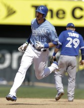 Kansas City Royals' Paulo Orlando (16) rounds the bases past Toronto Blue Jays second baseman Devon Travis (29) after his solo home run during the eighth inning of a baseball game at Kauffman Stadium in Kansas City, Mo., Sunday, July 12, 2015. The Royals defeated the Blue Jays 11-10. (AP Photo/Orlin Wagner)