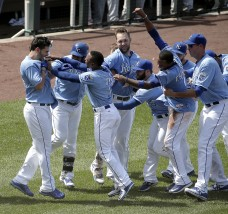 Kansas City Royals' Eric Hosmer, left, celebrates with teammates after hitting a double for the winning run in the ninth inning of a baseball game against the Minnesota Twins Sunday, July 5, 2015, in Kansas City, Mo. The Royals won the game 3-2. (AP Photo/Charlie Riedel)