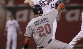 Kansas City Royals second baseman Omar Infante (14) throws to first for the double play hit into by Minnesota Twins' Miguel Sano after forcing out Eddie Rosario (20) at second during the eighth inning of a baseball game Saturday, July 4, 2015, in Kansas City, Mo. (AP Photo/Charlie Riedel)