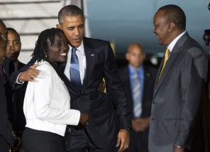 Kenyan President Uhuru Kenyatta, right, watches as President Barack Obama, center, hugs his half-sister Auma Obama, after he arrived at Kenyatta International Airport, on Friday, July 24, 2015, in Nairobi, Kenya. Obama is traveling on a two-nation African tour where he will become the the first sitting U.S. president to visit Kenya and Ethiopia. (AP Photo/Evan Vucci)
