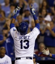 Kansas City Royals catcher Salvador Perez gestures as he crosses home plate after hitting a solo home run during the eighth inning of a baseball game against the Toronto Blue Jays at Kauffman Stadium in Kansas City, Mo., Friday, July 10, 2015. The Royals defeated the Blue Jays 3-0. (AP Photo/Orlin Wagner)
