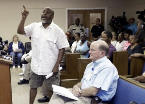 Dewayne Charleston speaks at a Waller County Commissioners Court meeting about the jail cell death of Sandra Bland in Hempstead, Texas, on Wednesday, July 22, 2015. Bland was arrested and taken to a jail about 60 miles northwest of Houston on July 10 and found dead July 13. Officials say Bland hanged herself with a plastic garbage bag in her jail cell, a contention her family and supporters dispute. (AP Photo/Pat Sullivan)