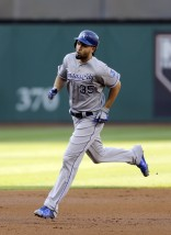 Kansas City Royals' Eric Hosmer runs the bases after hitting a three-run home run off Kansas City Royals starting pitcher Edinson Volquez in the first inning of a baseball game, Monday, July 27, 2015, in Cleveland. Mike Moustakas and Lorenzo Cain scored on the play. (AP Photo/Tony Dejak)