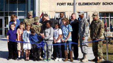 Kansas Gov. Sam Brownback, USD 475 Board of Education President Brian Field, USD 475 Superintendent Corbin Witt along with elementary school children and representatives of the Big Red One cut the ribbon for the new Fort Riley Elementary School in Fort Riley on Friday morning.