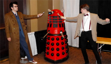 """A duo of Dr. Who cosplayers pose in front of a """"Red Dalek"""" inside the Manhattan Conference Center during Saturday's Little Apple Comic Con."""