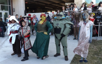 Winners of the Manhattan's first Little Apple Comic Con pose outside the Manhattan Conference Center Saturday afternoon.