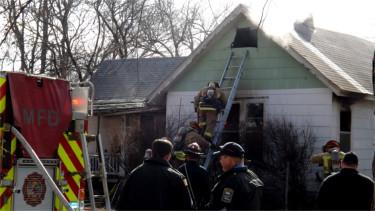 Manhattan firefighters attend to a house fire on 615 Yuma St. in Manhattan. (Staff photo by Brady Bauman)