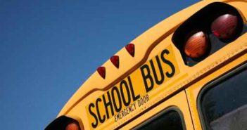 Semi avoids school bus, overturns Monday afternoon