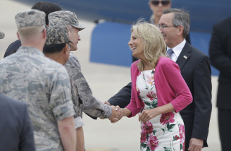Dr. Jill Biden, wife of U.S. Vice President Joe Biden, shakes hands with U.S. 7th Air Force Commander Lt. Gen. Terrence J. O'Shaughnessy upon her arrival for a two-day visit, at Osan Air Base in Pyeongtaek, south of Seoul, South Korea, Saturday, July 18, 2015. (AP Photo/Lee Jin-man)