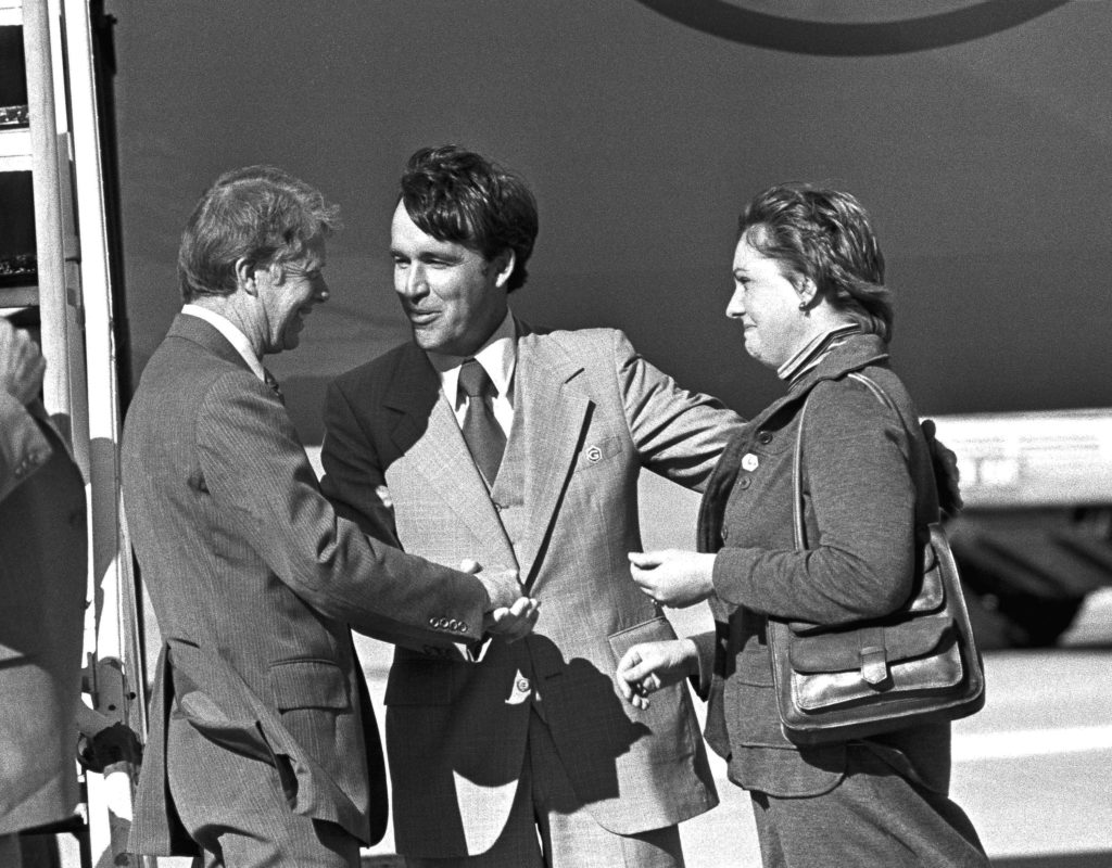Kansas Governor-elect John Carlin, center, introduces President Jimmy Carter, left, to his wife Ramona, right, after Carter's arrival in Kansas City on Nov. 9, 1978. President Carter held a news conference and addressed the Future Farmers of America convention. (AP Photo/John Filo)