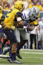 Kansas State wide receiver Byron Pringle (9) is tackled by West Virginia safety Jeremy Tyler (2) during the first half of an NCAA college football game, Saturday, Oct. 1, 2016, in Morgantown, W.Va. (AP Photo/Raymond Thompson)