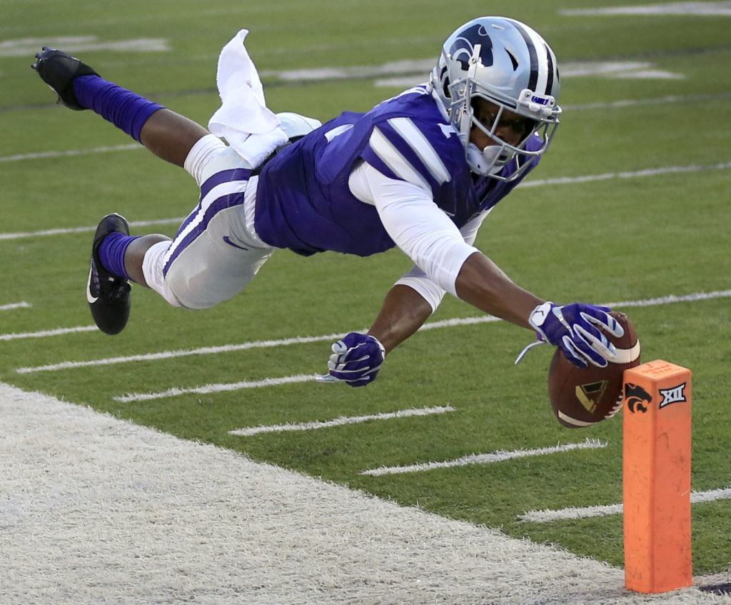 Kansas State wide receiver Isaiah Zuber dives for a touchdown during the first half of an NCAA college football game against Texas Tech in Manhattan, Kan., Saturday, Oct. 8, 2016. (AP Photo/Orlin Wagner)