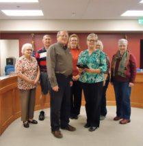 Back Row L/R. Board member B. J. Kerr, Leo Sauer, Roxanne Linnebur, Board member Sue Gordon, Resident Ila Jean Bartels and Board member Sue Gordon.   Front Row:  Ken Stein & Joni Chrest.