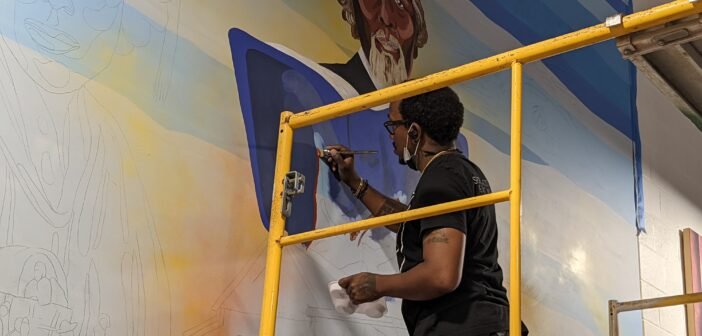 Wichita native returns to paint Douglass Activity Center mural